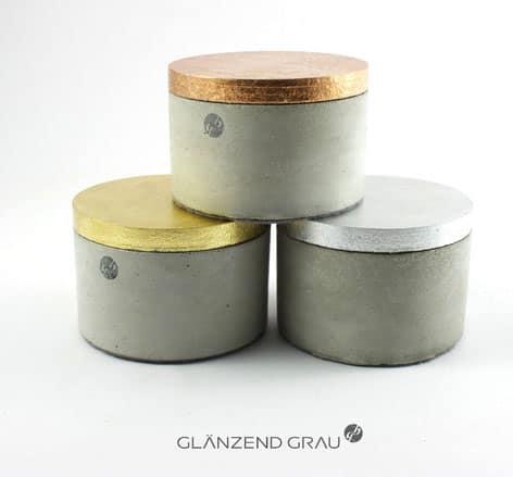 Betondosen mit HolzdeckelCopyright: http://de.dawanda.com/shop/glaenzend-grau