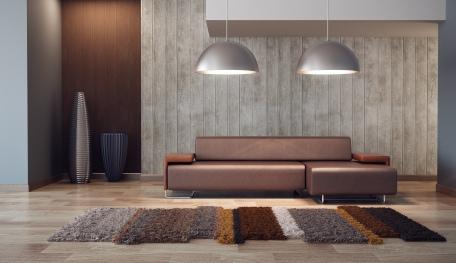 Ein Designer Teppich verleiht dem Raum eine exklusive und gemütliche Note.